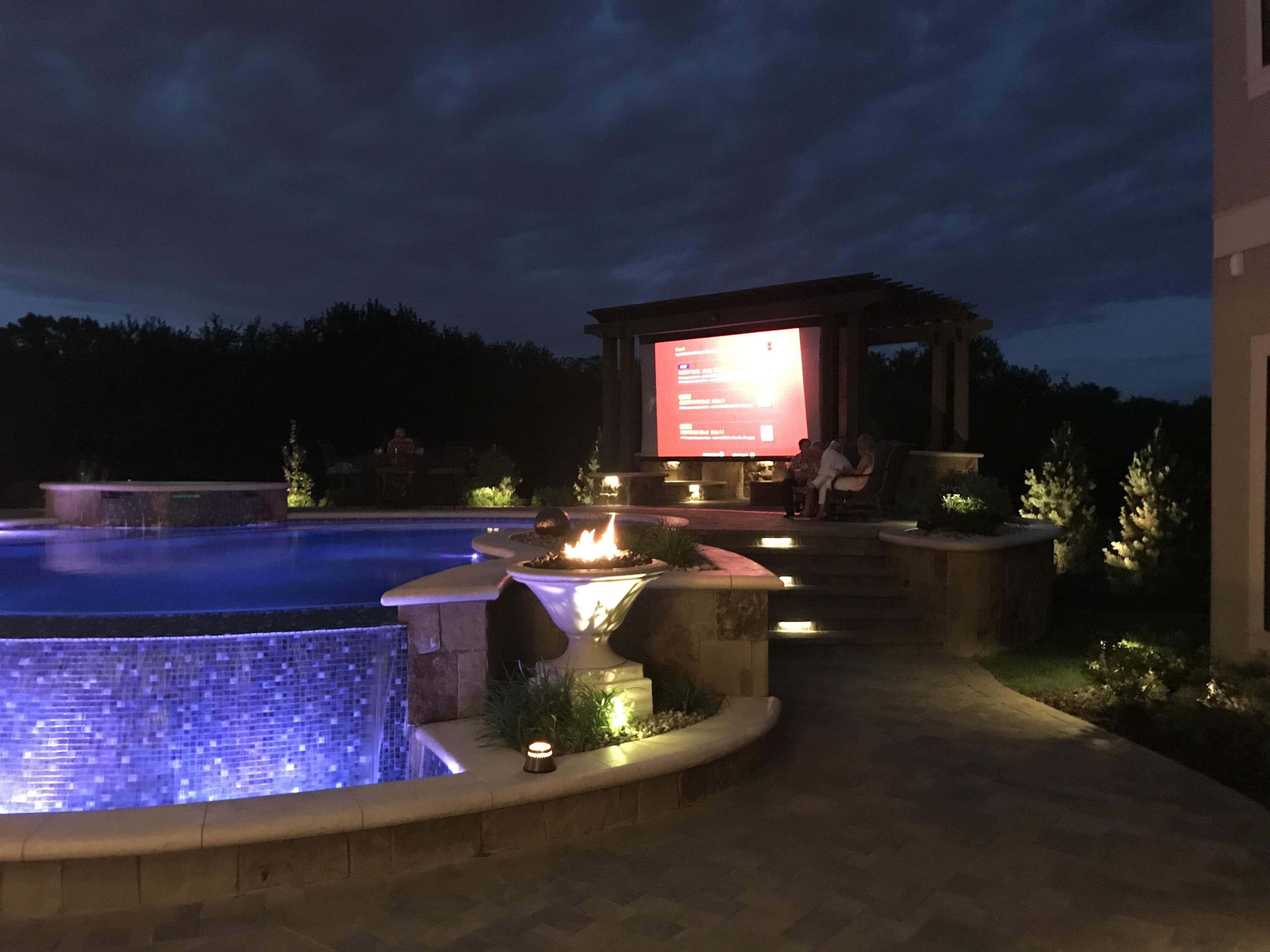 Outdoor poolside tv screen.